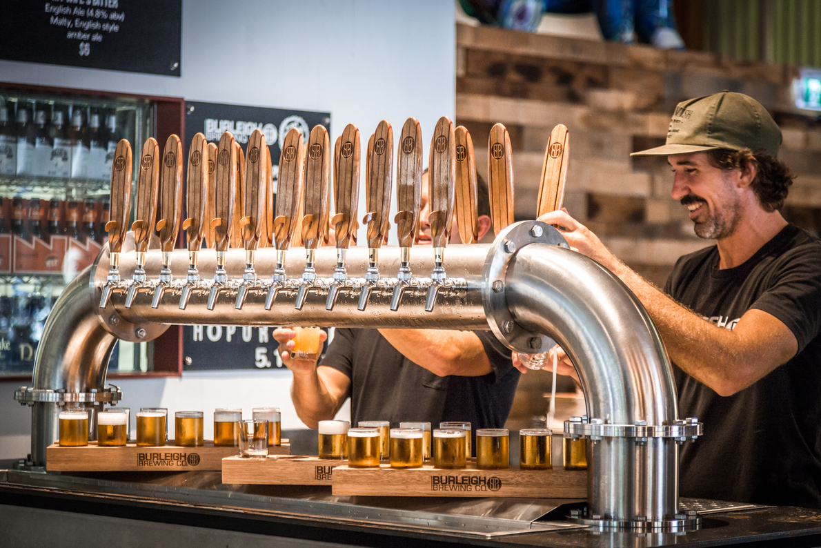 Burleigh Brewing Co men pulling beer (1)